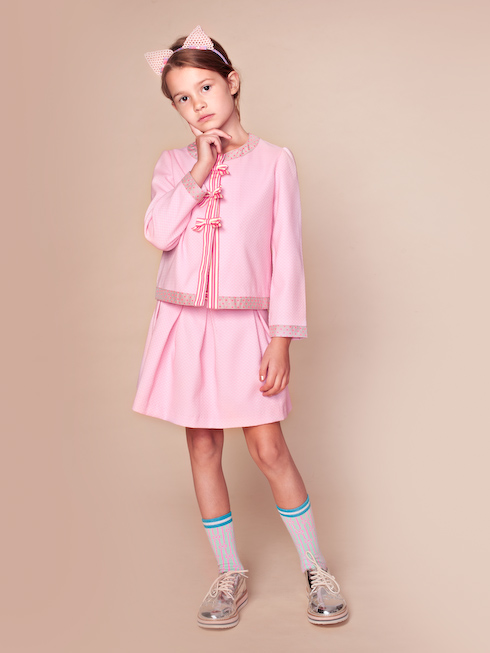 ピンク色のキッズカーディガンです。