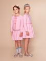モデル着用画像(左) - ピンク色キッズスカート
